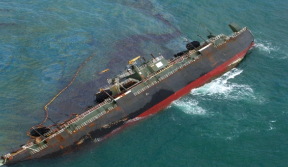 Disabled  Tank Barge DBL 152 vessel before capsizing showing discharge of oil.